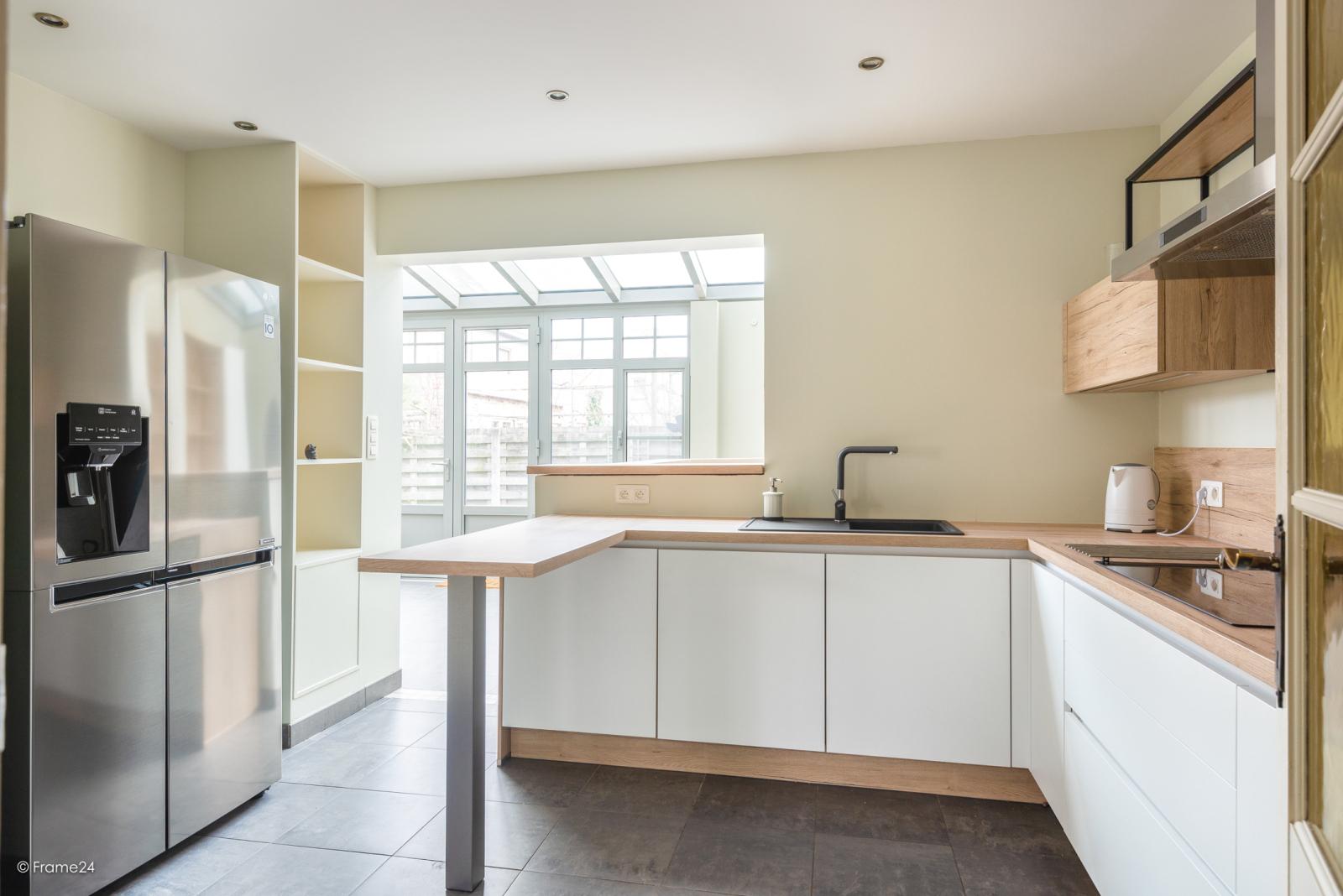 Charmante halfopen bebouwing met twee slaapkamers op zeer goede locatie te Wijnegem.  afbeelding 10