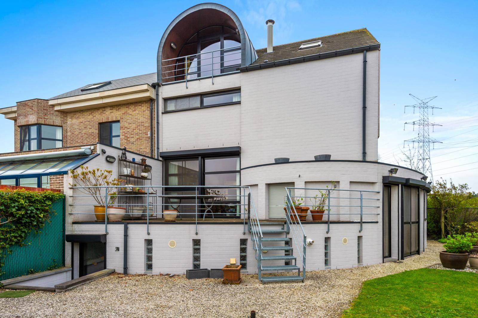 Architecturale halfopen woning met prachtig uitzicht op een perceel van 575 m² te Aartselaar! afbeelding 21
