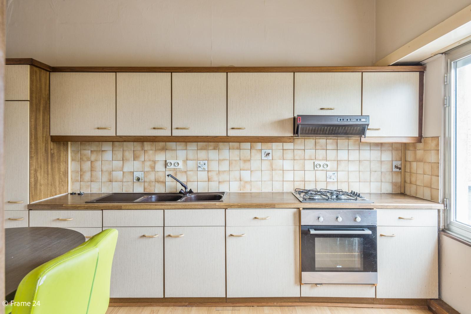 Te renoveren woning met tal van mogelijkheden in het centrum van Oelegem! afbeelding 17