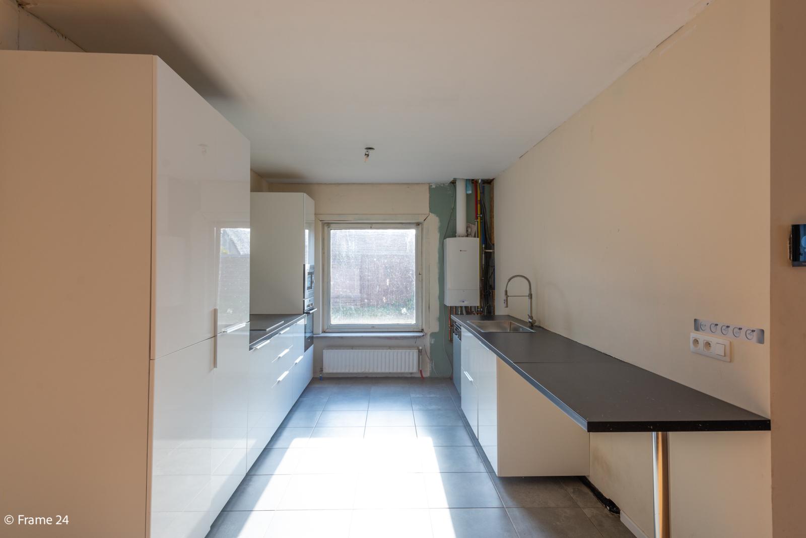 Winkelruimte met woonst op commerciële toplocatie te Zandhoven! afbeelding 11