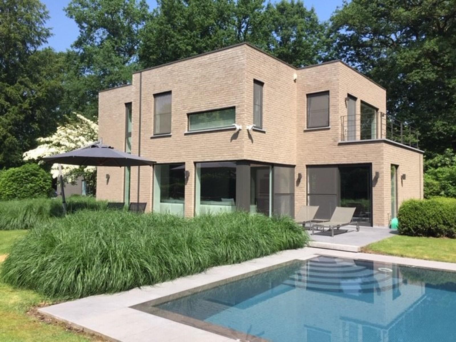 Op een perceel van 5.570 m² treffen we deze luxueuze villa mét zwembad! afbeelding 22