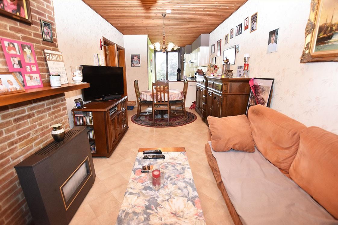 Deels te renoveren Confortawoning met twee slaapkamers en tuin te Deurne! afbeelding 1
