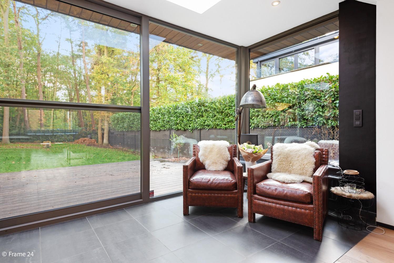 Vernieuwde villa met vijf slaapkamers en prachtige tuin op een perceel van 1.207 m² te Wijnegem! afbeelding 4