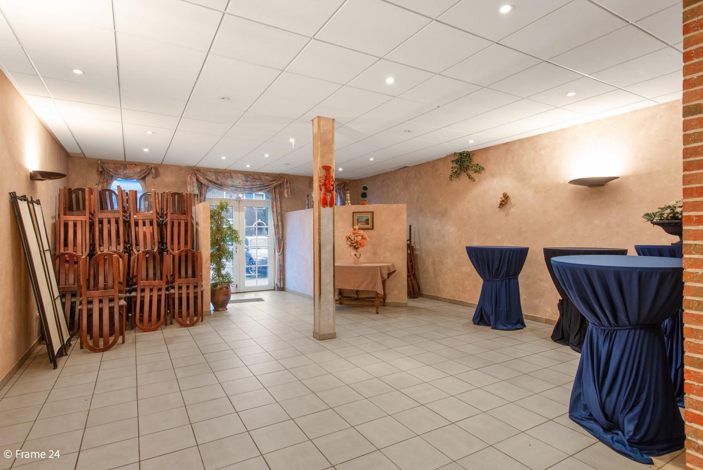 Commercieel gebouw (415m²) met handelsruimte & woonst op gunstige locatie in Wijnegem! afbeelding 14