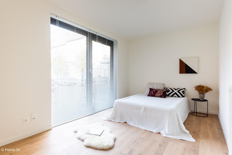 Licht en ruim gelijkvloers nieuwbouwappartement (+/-110 m²) met 3 slaapkamers, ruim zuid-gericht terras alsook parktuin. afbeelding 9