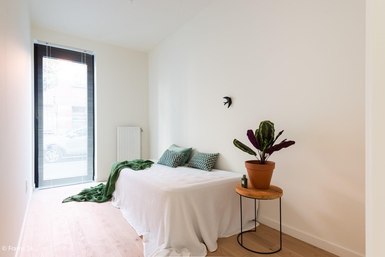 Licht en ruim gelijkvloers nieuwbouwappartement (+/-110 m²) met 3 slaapkamers, ruim zuid-gericht terras alsook parktuin. afbeelding 12