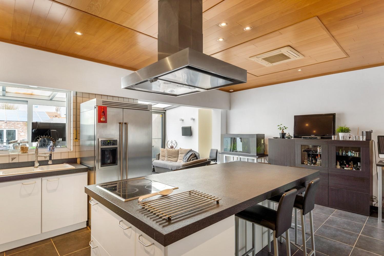 Verrassend ruime woning met groot werkhuis, jacuzzi, sauna, zonnepanelen en 3 slaapkamers in Wommelgem! afbeelding 6