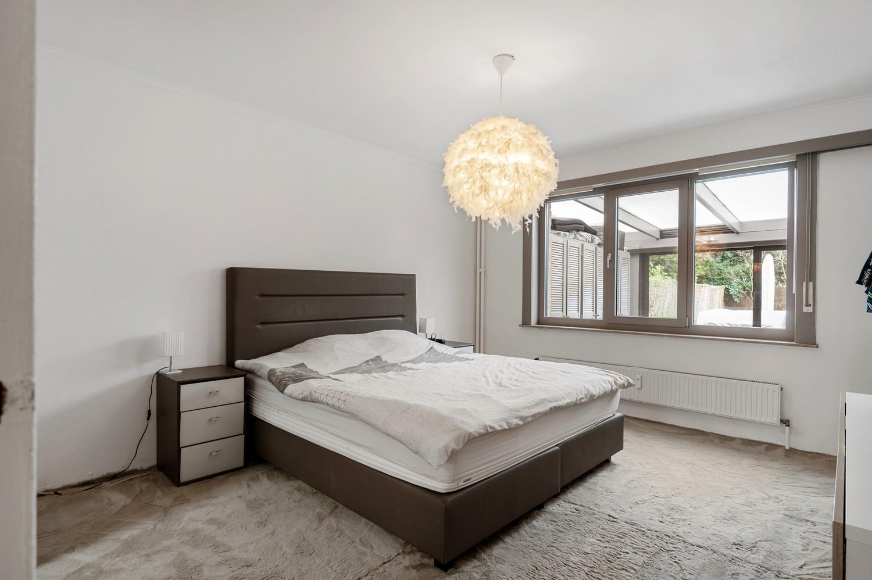 Gerenoveerd gelijkvloers appartement met 2 slaapkamers en tuin te Deurne! afbeelding 7