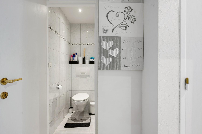 Gerenoveerd gelijkvloers appartement met 2 slaapkamers en tuin te Deurne! afbeelding 11