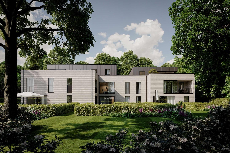 Licht en functioneel appartement (+/-106,76m²) met 2 slaapkamers, terras en zuid georiënteerd privatieve tuin (+/-73,85m²)! afbeelding 3