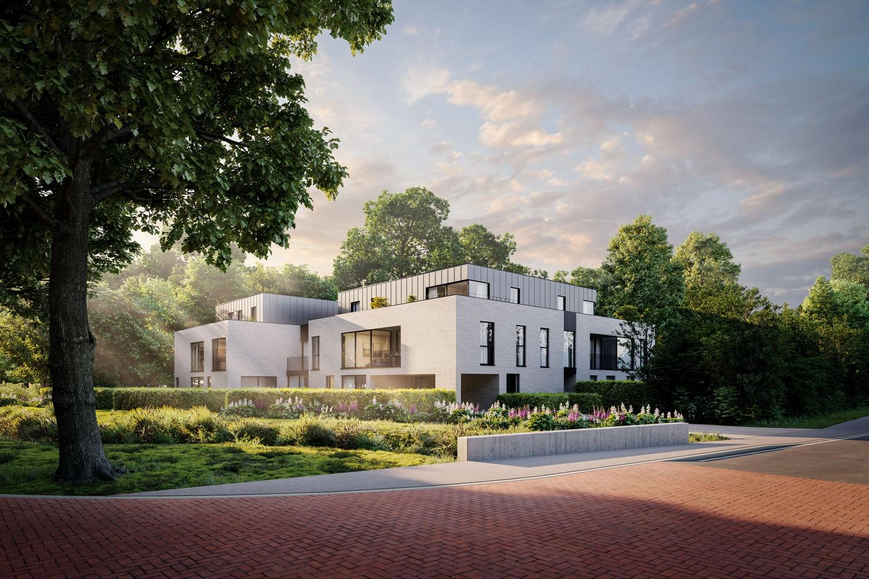Licht en functioneel appartement (+/-103,55,00m²) met 1 slaapkamer, terras en zuid-georiënteerd privatieve tuin (+/-98,12m²)! afbeelding 2