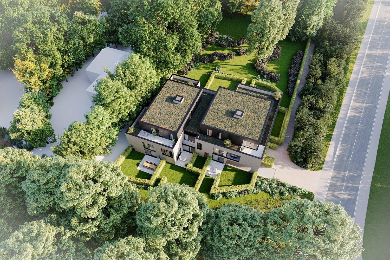 Licht en functioneel appartement (+/-103,55,00m²) met 1 slaapkamer, terras en zuid-georiënteerd privatieve tuin (+/-98,12m²)! afbeelding 5
