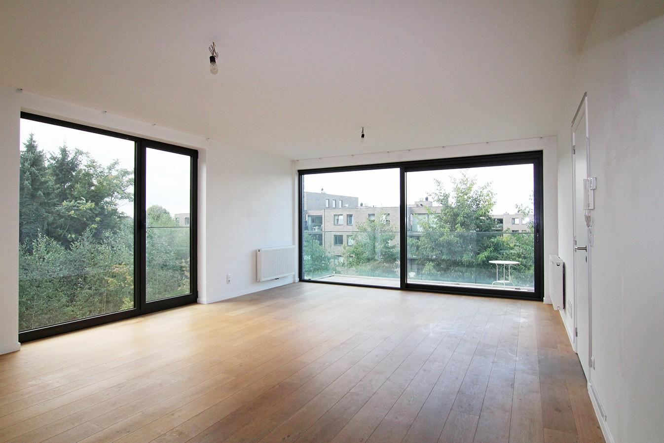 Recent appartement met twee slaapkamers en terras op rustige en groene locatie te Wijnegem! afbeelding 2