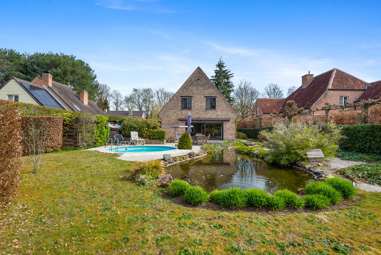 Verrassend ruime woning met idyllische tuin op een zeer gunstige locatie in Oelegem! afbeelding 17