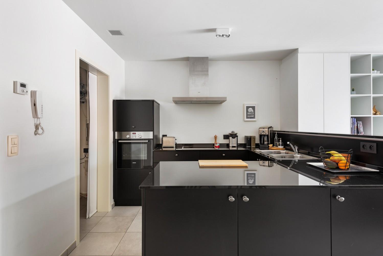 Recent, gelijkvloers appartement met 2 slaapkamers, ruime tuin, garagebox & berging! afbeelding 6