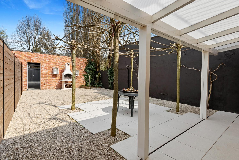 Recent, gelijkvloers appartement met 2 slaapkamers, ruime tuin, garagebox & berging! afbeelding 13