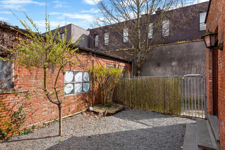 Huis bestaande uit twee wooneenheden met oprit en magazijn! afbeelding 28