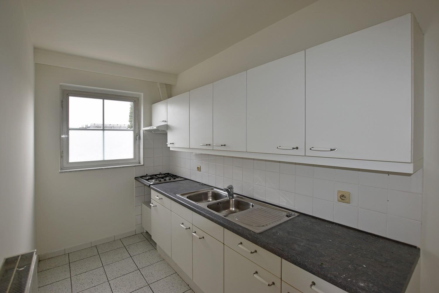 Verzorgd appartement met twee slaapkamers en terras te Deurne. afbeelding 2