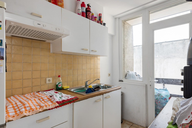 Opbrengsteigendom bestaande uit 3 appartementen en 4 garageboxen te Merksem. afbeelding 6