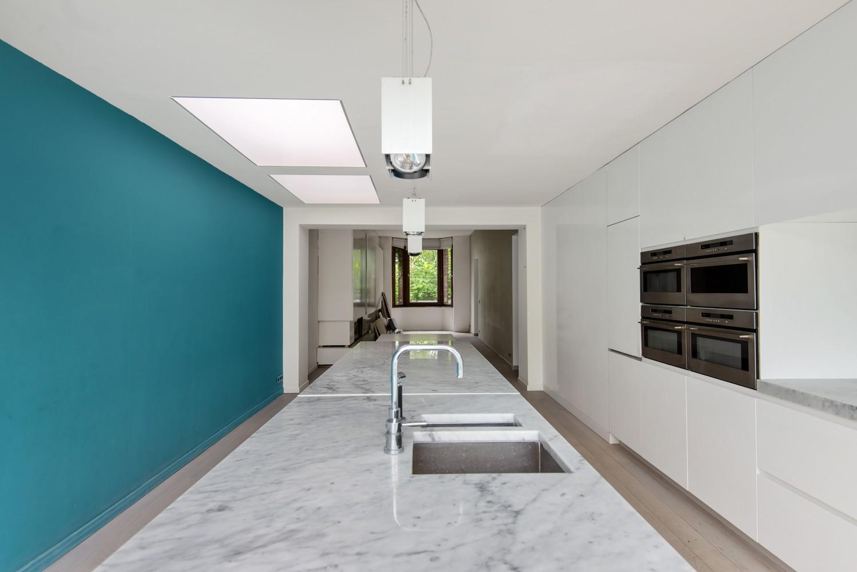 Verrassend ruime woning met 5 slaapkamers en leuke tuin te Merksem! afbeelding 8