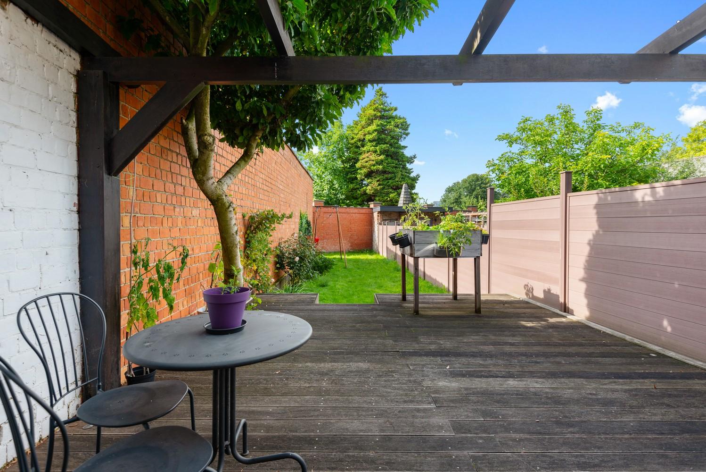 Charmante, deels te renoveren rijwoning met 3 slaapkamers en leuke tuin te Deurne! afbeelding 2