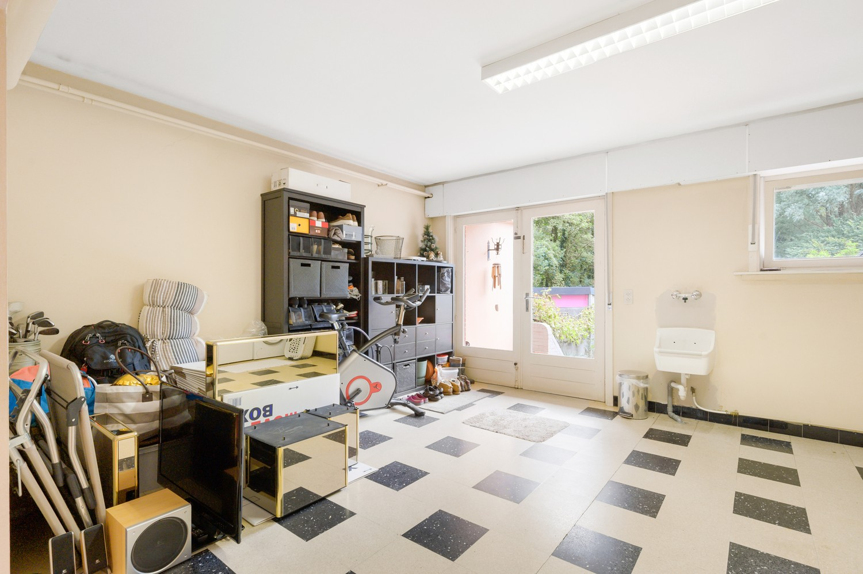 Verzorgde bel-étage woning met drie slaapkamers en zonnige tuin te Wijnegem. afbeelding 24