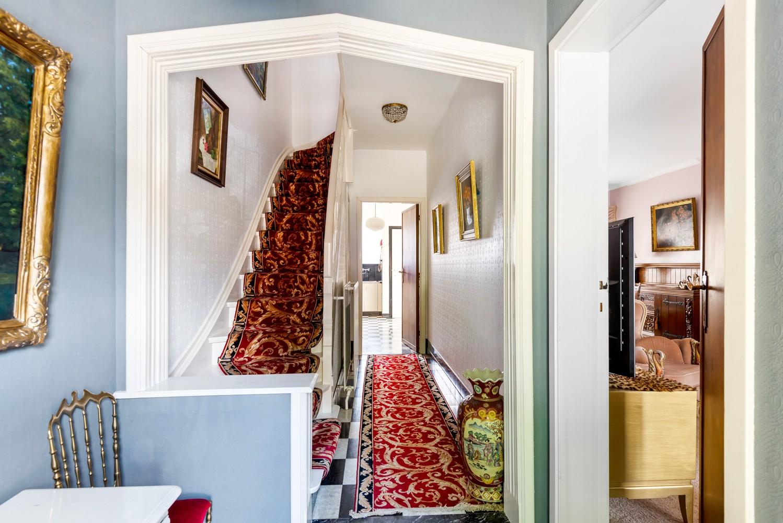 Te renoveren eengezinswoning met drie slaapkamers, inpandige garage, zolder en mooie tuin te Wijnegem! afbeelding 17