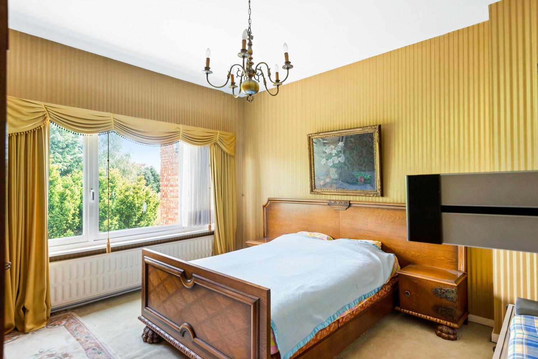 Te renoveren eengezinswoning met drie slaapkamers, inpandige garage, zolder en mooie tuin te Wijnegem! afbeelding 13