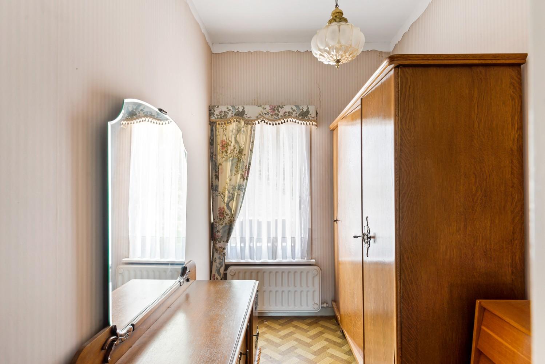Te renoveren eengezinswoning met drie slaapkamers, inpandige garage, zolder en mooie tuin te Wijnegem! afbeelding 15