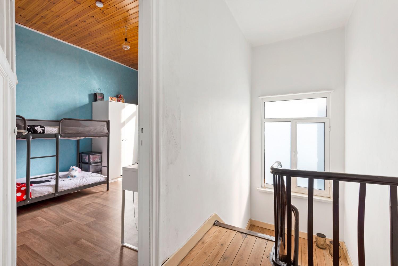 Rustig gelegen, op te frissen eengezinswoning met twee slaapkamers en leuke tuin te Wijnegem. afbeelding 9