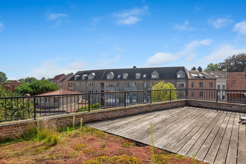 Modern éénslaapkamerappartement met zonnig terras in hartje Zandhoven! afbeelding 1