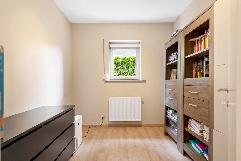 Modern gelijkvloers appartement met leuke tuin, 2 slaapkamers en autostaanplaats in Wommelgem! afbeelding 12