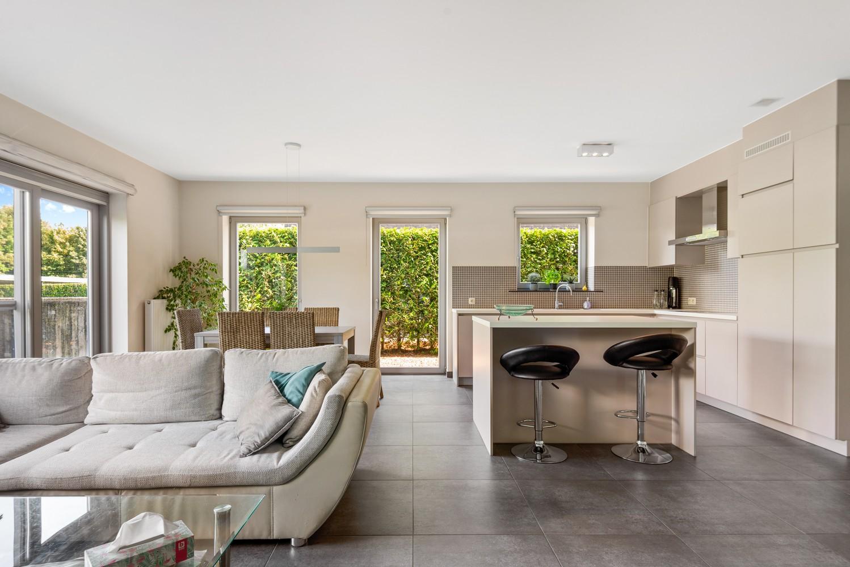 Modern gelijkvloers appartement met leuke tuin, 2 slaapkamers en autostaanplaats in Wommelgem! afbeelding 4